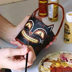 Papier-Mache Candy Container http://www.bhg.com/halloween/crafts/papier-mache-candy-container/