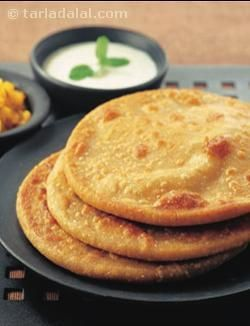 Wheat flour parathas stuffed with a spicy moong dal filling.