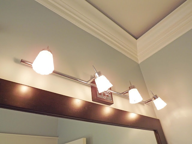44 best must love budget bathroom upgrades images on pinterest another stylish use for track lighting put it in the bathroom mozeypictures Gallery