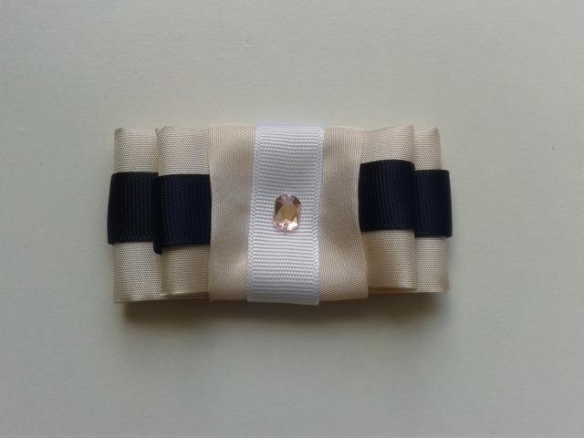 Bow brooch. Pastel with navy ribbon.