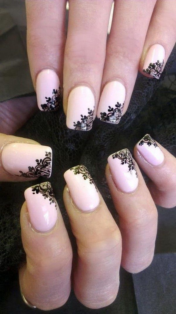 Fashionable black lace on pink nail polish base.