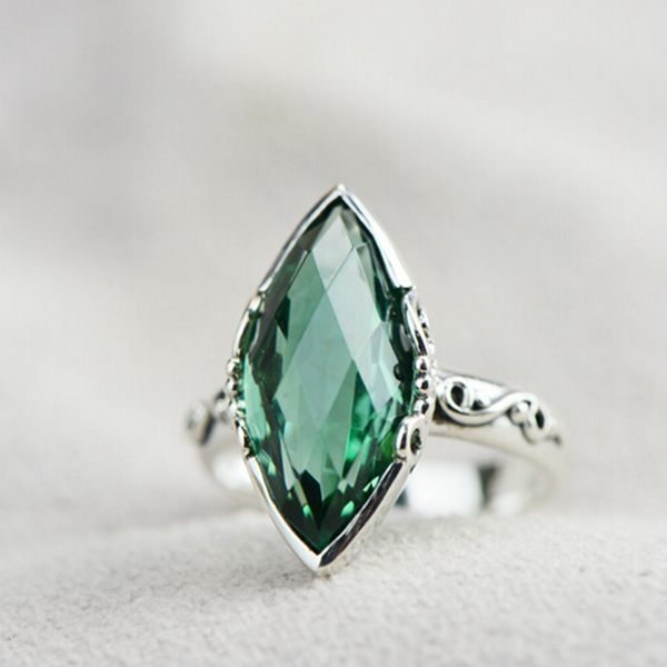 7 jaw droppingly unique engagement rings - Emerald Wedding Rings