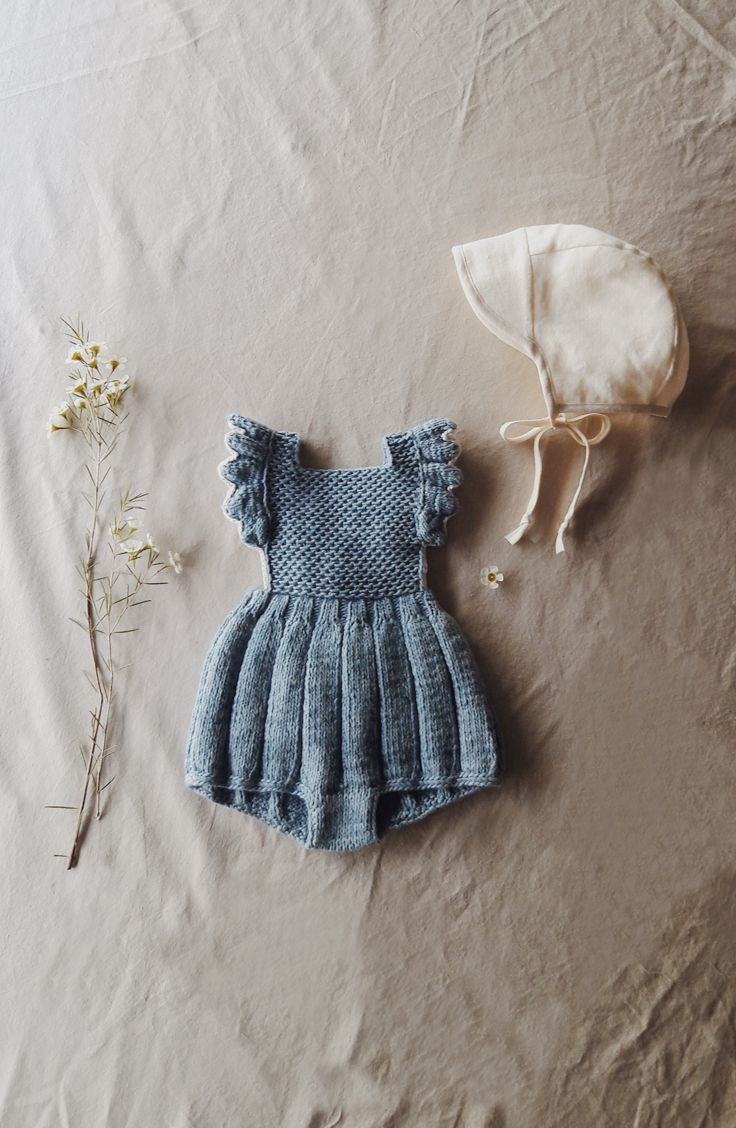 Perfect vintage style springtime baby girl outfit. Hand-knit from hand-dyed organic cotton. Sweet little sunsuit paired with sunbonnet for boho chic babes. By Misha and Puff for Noble Carriage.