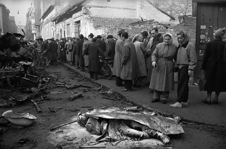 ERICH LESSING - HUNGARIAN REVOLUTION 1956 --- Citizens queuing for food look at destroyed tanks and dead Soviet soldiers in a Budapest street. More photos here: http://blog.burnedshoes.com/post/80507359045