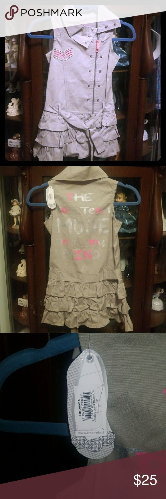 "Girls khaki Limonada Dress ADORABLE khaki and pink army themed dress with ruffles at the bottom and lettering on the back which reads,  "" The Top Teen Mode on in my Mind"" 🎀SUPER🎀cute and girly, and can even be worn as a school uniform for those with dress codes like here in Florida.  🎀NWT, NEVER worn🎀 🎀Size 8 and comes just below the knees, or 27 inches in length/ top of collar to the very last bottom ruffle👗👗 🎀11 and a half inches pit to pit. 🚭🚫Smoke free home 🚫🚭 Limonada…"