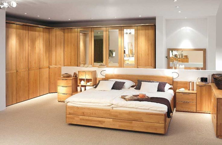 Large Modern Bedroom Cupboards with brown natural color wooden bed frames and headboard also white black colors covered bedding sheets and pillows
