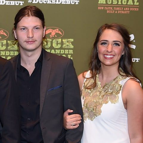 Reed Robertson and his girlfriend Brighton Thompson attend the