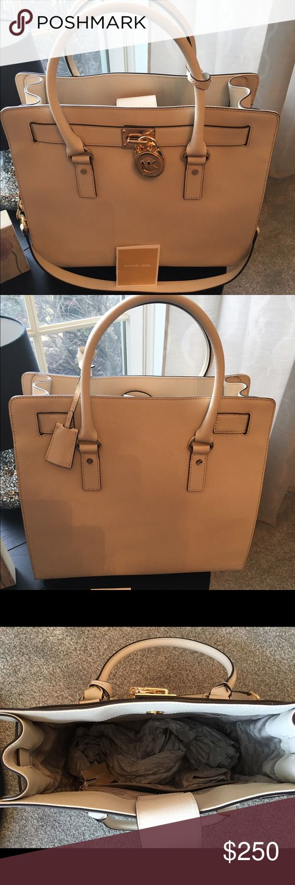 Michael Kors Hamilton traveler bag/ purse. NWT Cream in color with gold chain and emblems ... nice large size bag ... has shoulder strap and handles Michael Kors Bags Shoulder Bags