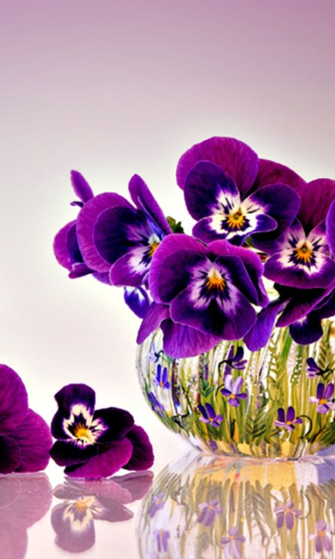 Pansies in a glass vase painted with little pansies
