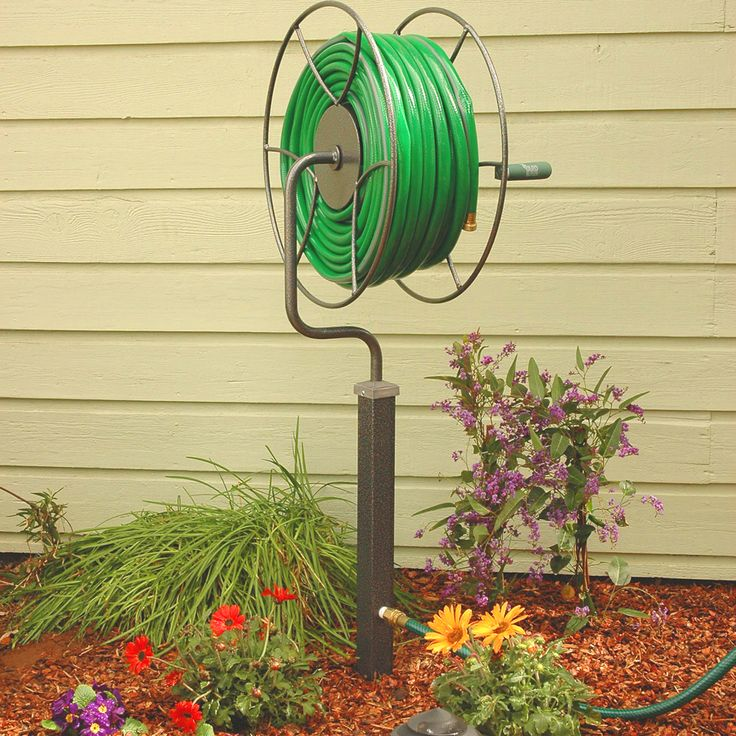Garden Hose Storage Ideas hide your garden hose with an awesome bench Free Standing Swivel Reel Garden Hose Storage Reg 170 Sale 150