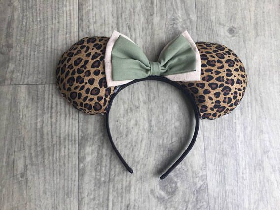 These hand-made Animal Kingdom inspired Safari mouse ears are WILD about the magical world of Disney. This listing is for the purchase of ONE of the two animal print mouse ears pictured above. For the giraffe print ears, which is the first picture with the larger spots, select Option A at