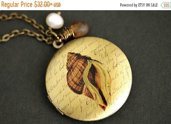 SUMMER SALE Brown Seashell Locket Necklace. Conch Shell Necklace with Mottled Brown Teardrop and Fresh Water Pearl Charm. Bronze Locket. by TheTeardropShop from The Teardrop Shop. Find it now at https://ift.tt/2MazlwS!