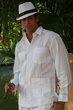 Menswear for a beach wedding (Caribbean region): guayabera shirt and khakis. Click the photo for information about cut, color, and material suitable for the event. The shirts can be ordered here: http://www.mycubanstore.com/