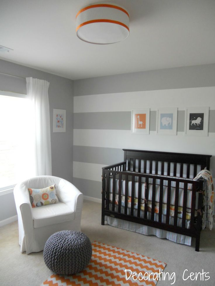 Grey and White walls. One with stripes then the rest solid.