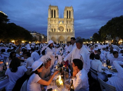 The White Dinner in Paris. Held in front of Notre Dame Cathedral, I want to go this summer... how awesome would that be? :)