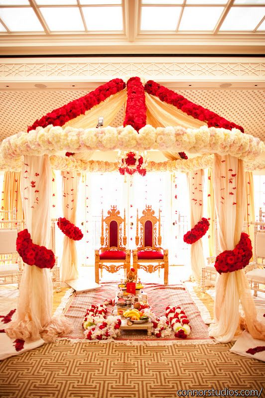Beautiful red and cream man dap design using fresh #flowers.  TIP for selecting your venue. Make sure that the venue you select HELPS with your color scheme and overall wedding #theme. You hold not be fighting with the existing venue decor, carpet, color scheme, etc. to make your vision work. -BE  www.EventDesignbyBE.com