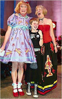 Ceramic artist Grayson Perry poses with his wife Phillippa and daughter Flo after winning the prestigious Turner Prize- dresses are his own creations.