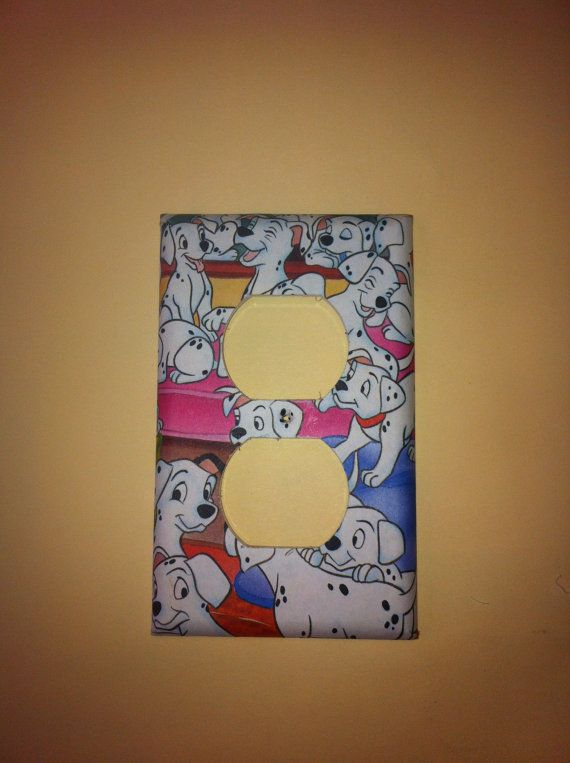 101 Dalmatians Electrical Cover. The photo came from a Disney 101 Dalmatians book. The electrical plate was made with decoupage method and has