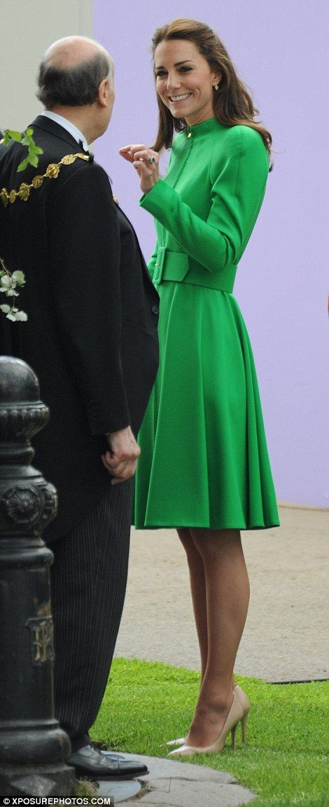 Kate looked stunning in a vibrant green coat dress and was in high spirits for her first visit to the flower show