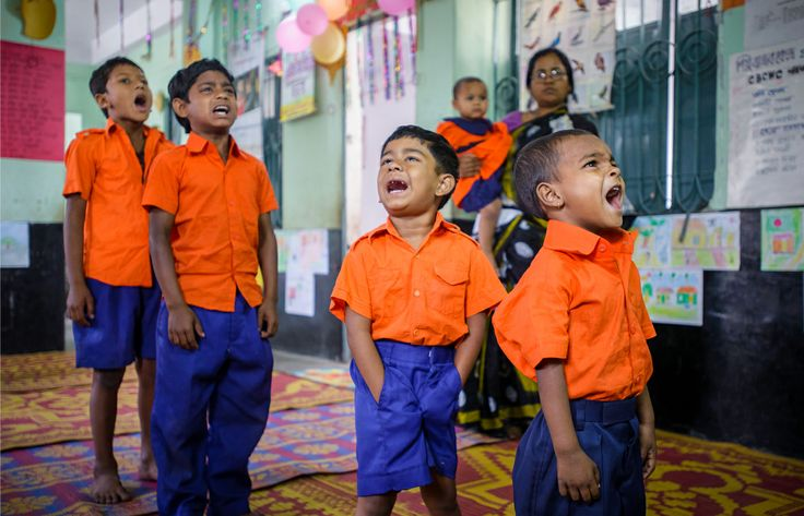 MOST SCHOOL SPIRIT: With gusto, these four pupils at World Vision's Child-Friendly Space in Jessore, Bangladesh, belt out the country's national anthem at the beginning of each school day. All four boys are sons of women who work in a brothel just across the alley from the school. But here in this safe place, they are cared for and loved — and they can sing as loud as they like. (©2013 Jon Warren/World Vision)