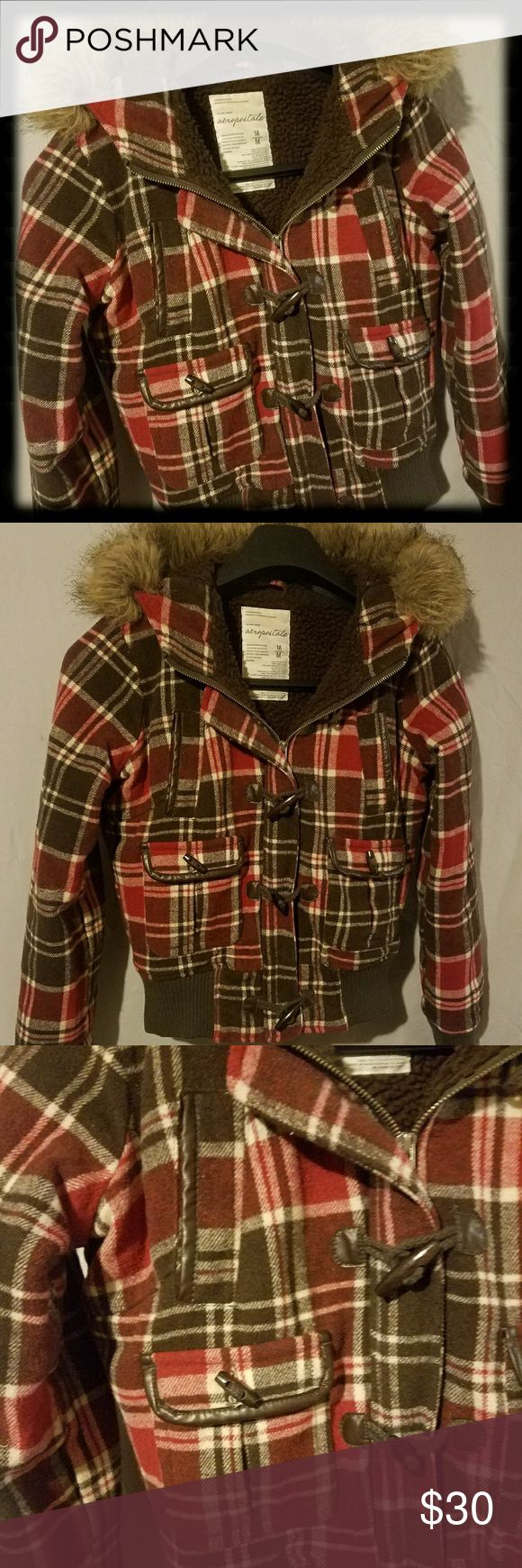 Aeropostale Women's Wool Red & Brown Plaid Coat Aeropostale Women's Wool Red & Brown Plaid Coat Sz Med. Had faux fur around hood that can be removed. Zip & button front. Retro 70's look. Very good condition. Aeropostale Jackets & Coats Utility Jackets
