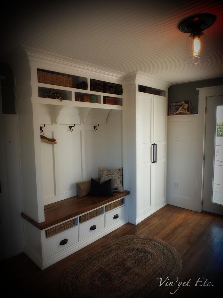 Mud room/pantry combo. Bottom drawers wold be cubbies only. Simplify top shelves