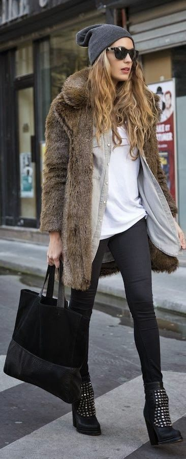 fur coat + leather skinny + oversized top + studed boots + knitted hat = perfect street fash look