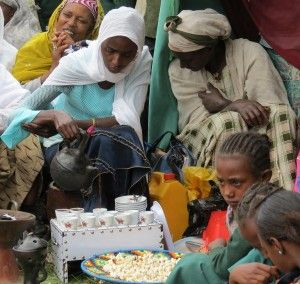 Ethiopia: Traditional coffee ceremony.  See the popcorn in the basket at the foot of the table holding the cups?