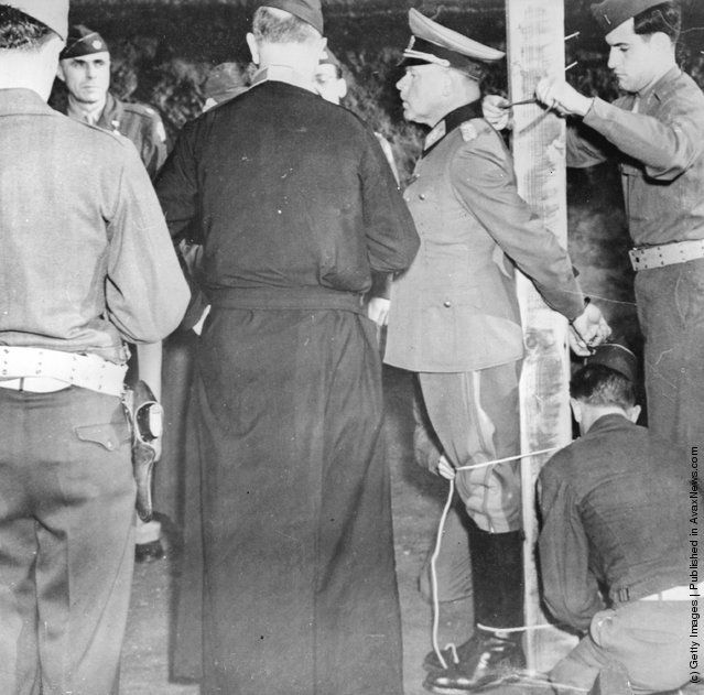 The first Nazi General to be executed, Anton Dostler, is tied to a post in Aversa to face a US Army firing squad. He was tried by an American military tribunal for the summary shooting of 15 prisoners while serving as the General Commanding the 75th German Army Corps. (Photo by Keystone/Getty Images). 1945