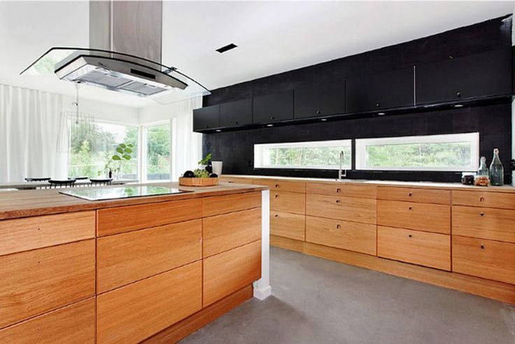 Walnut fronts and black splash back -can switch to have dark stain on cabinets but wouldn't recommend timber splash back - at least not walnut!
