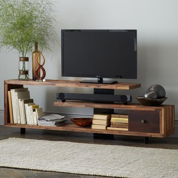 West Elm - Spiraling wooden shelves offer plenty of surface space for your tv, record player, speakers, radio, and more than a few books.