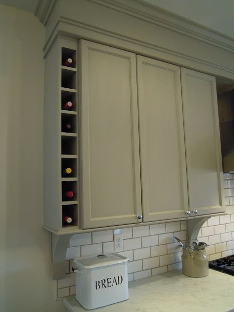 "Chris Kauffman kitchen reno/MS Bedford Gray: ""The little touches like this wine storage to balance out the extended bulkhead , turns out it created a great opportunity for this useful feature."""