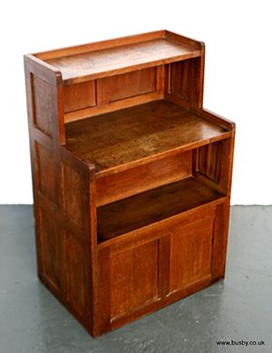An oak panel cabinet with cupboard back 36¼in(92.5cm)H