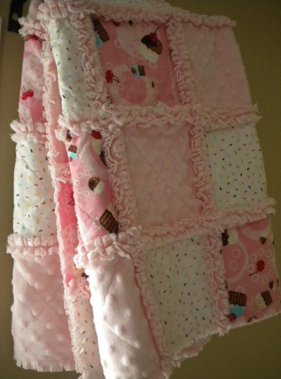 "This sweet cupcake baby girl rag quilt blanket is made with two fabrics from the Robert Kaufman Confections Collection and super soft pink dot minky. It measures at 32"" x 36"". Perfect size for baby or toddler.    The middle layer is soft pink flannel and the back is super soft minky dot."