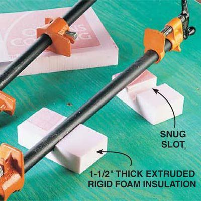 DIY Tip of the Day! Do your pipe and bar clamps flop over during gluing jobs, causing you to come unglued along with the boards? Make supports for your clamps from 1-1/2-in.-thick rigid foam insulation. Use a utility knife or saw to cut friction-fit slots for the pipes or bars. Now the clamps--and you--will remain stable during gluing jobs.