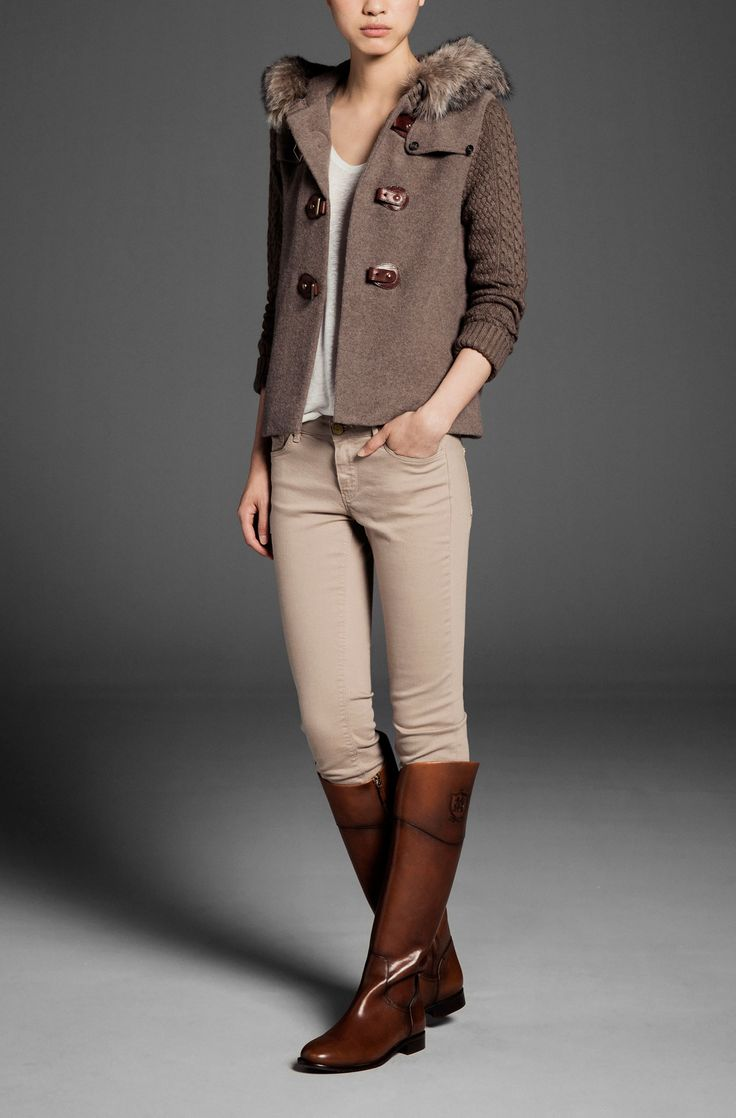 Tall boots with light colored neutrals make for a chic #traveloutfit. Massimo Dutti