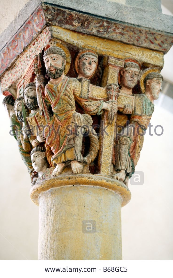 Sculpture on capital columns, Interior of Romanesque church (1080), Saint Nectaire, Auvergne, France Stock Photo