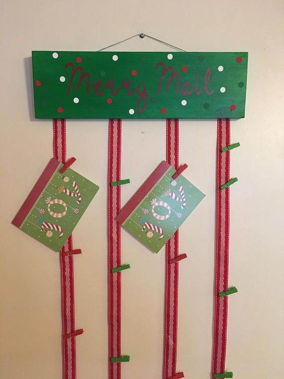 Are you looking for a great way to display all of those Christmas cards? Well this Merry Mail Sign is a great for you! The sign measures 15 wide x 5 high x 3/4 thick. The wood is cut and then sanded by me. I then paint the sign with holiday green paint and it is sealed with mod