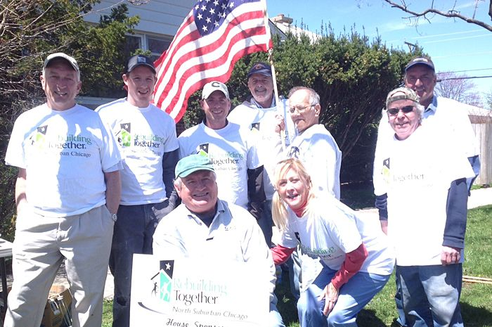 Glenview Lions Club members recently painted and renovated an Evanston home through the Rebuilding Together organization.