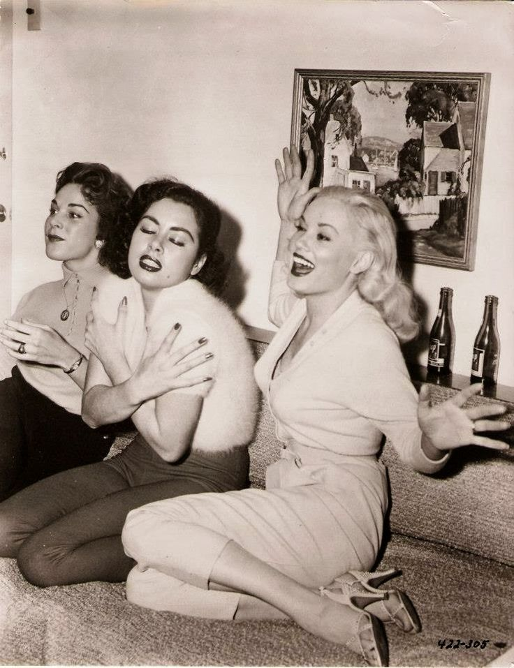 "Valerie Reynolds, Jeanne Carmen and Mamie Van Doren at the ""Untamed Youth"" post-premier party, 1957."