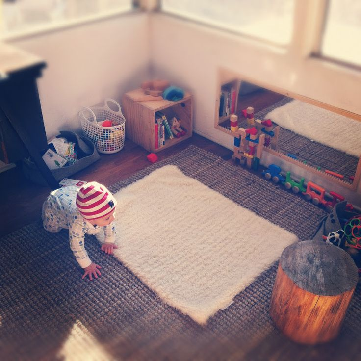 This has inspired my baby play corner in our family room. Love all the light, mirror and wood toys. I need felt baskets!