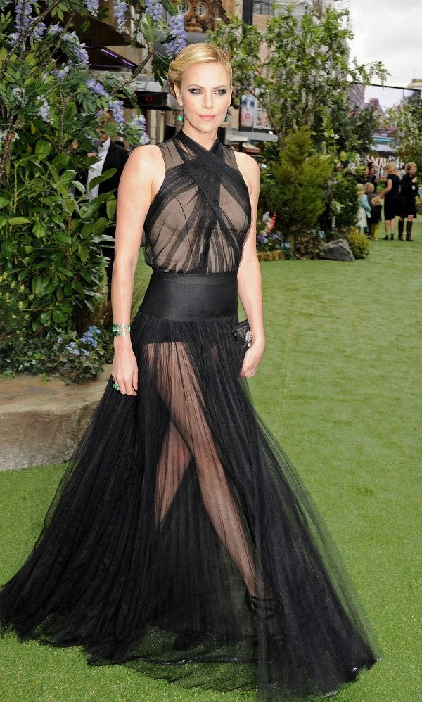 Here are 21 pics of CHARLIZE THERON at Snow White and the Huntsman Premiere in London. The hot actress is wearing black see-through Christian Dior Haute Couture with Solange Azagury-Partridge jewelry.