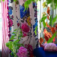 Designers Guild Amrapail fabric The award winning Amrapali fabric is one of our favourite fabrics. It is a casade of summer flowers. See the gorgeous Amrapali cushions in the cushion section.