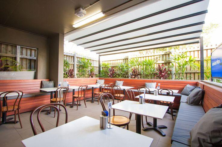 Recently completed Mediterranea retractable fabric roof (light grey fabric, black support bars) | Story Bridge Deli. Brisbane.