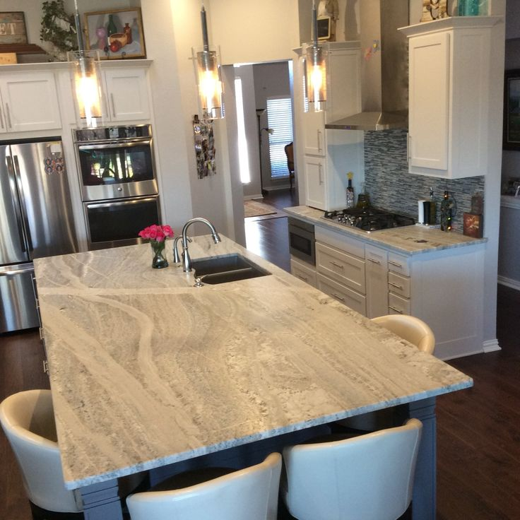 High Quality Arizona Tile Carries Monte Cristo In Natural Stone Granite Slabs Displaying  White, Silver, Yellow, Gold And Bluish Tones.