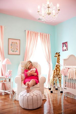 Aqua & Pink nursery - Love the pom in front of the glider!  Pink ceiling, chandelier, giraffe and sweet crib.