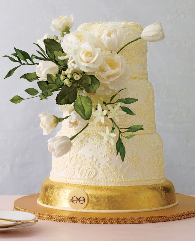 Gorgeous white floral wedding cake with a small layer of metallic gold at the bottom #wedding #weddingcake #cake #gold #goldwedding