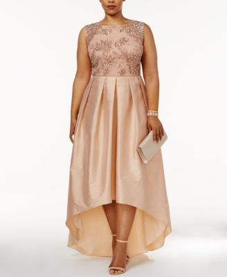 Adrianna Papell Plus Size Embellished Taffeta High-Low Gown $369.00 Sparkle and shine from head to heels in Adrianna Papell's radiant plus-size gown.