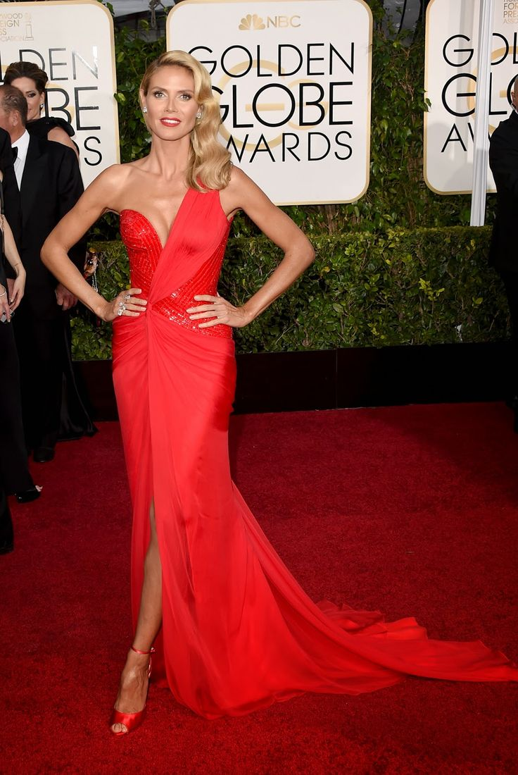 Heidi Klum in an Atelier Versace dress. ♥ If you enjoyed my pin, pls do visit my celebrity site at www.celebritysize... ♥ #celebritysizes