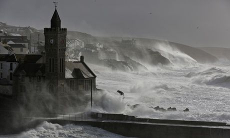Waves break at high tide in Porthleven, Cornwall, on Saturday as south-west England and Wales braced for more storms and flooding. Photograp...